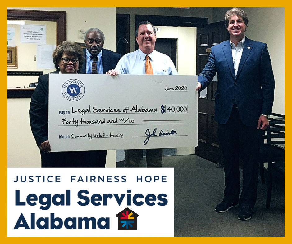 Photo of attorneys at Mobile office receiving a check from Hancock Whitney Bank